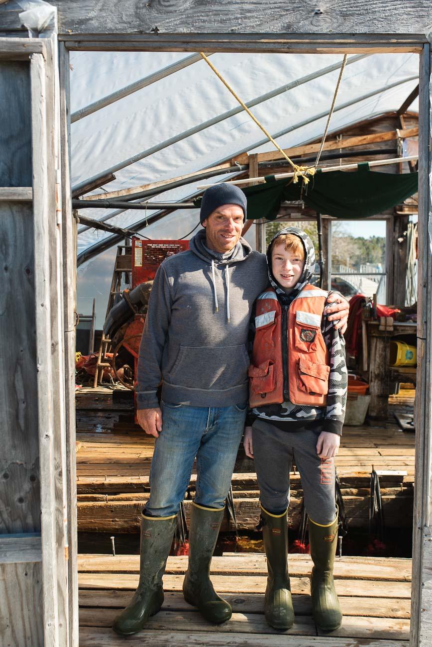 A portrait of Chris Warner and son Garrett of High Tide Oyster Farm.